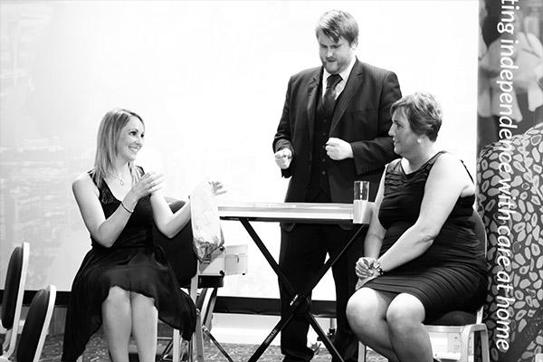 Emma Miller with Chris Whitelock doing a magic trick