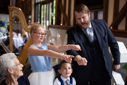 Chris whitelock performing a magic trick on wedding guests