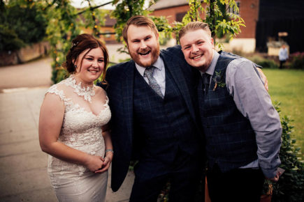 Chris Whitelock with the bride and groom at their wedding